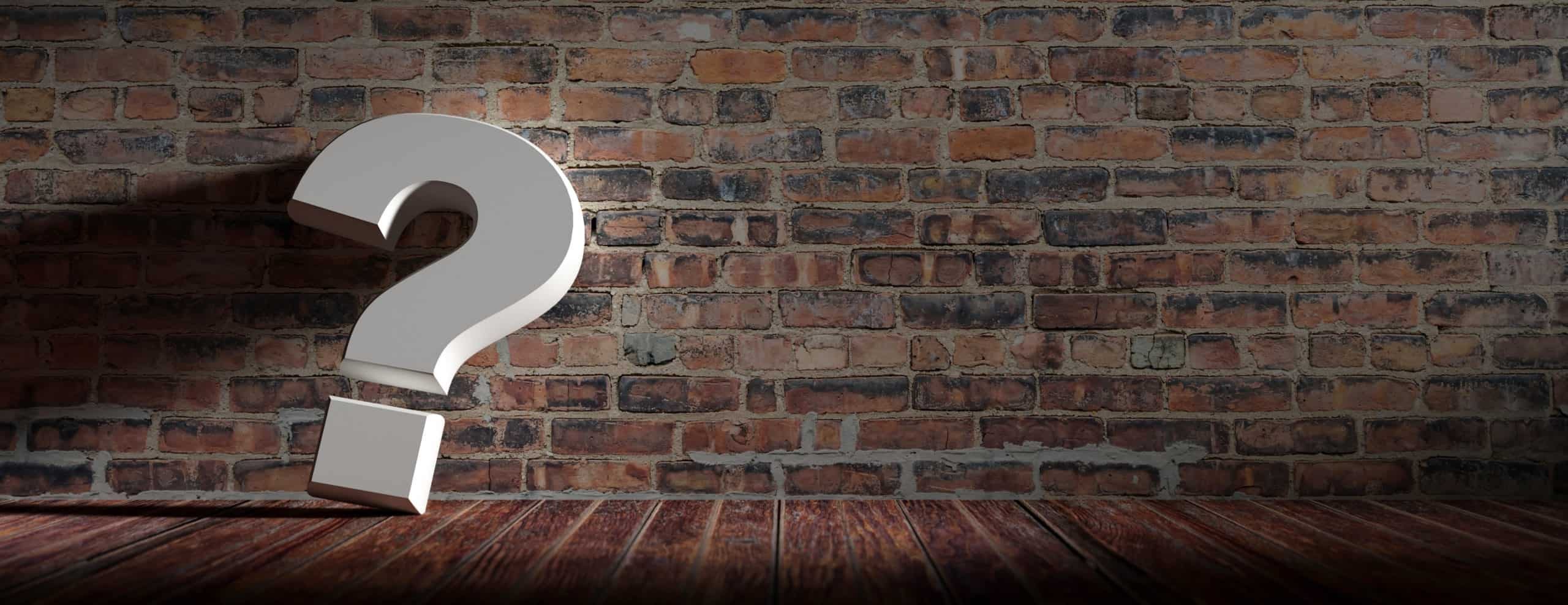 Question mark on wooden floor and vintage brick wall background. Interior decoration concept. Banner, copy space. 3d illustration